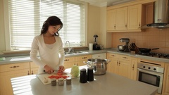 MS Woman cutting vegetables in kitchen / China Stock Footage
