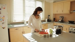 DS MS Woman cutting vegetables in kitchen / China Stock Footage