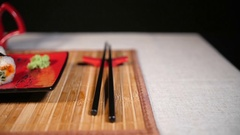 Slide Motion of Sushi With Chopsticks and Souce Stock Footage