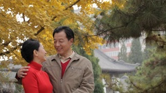 MS Elderly couple laughing and talking, standing in park / China Stock Footage