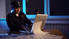 Police officer USA working in the office over the disclosure of the crime Stock Footage