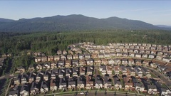 Aerial of Suburban Cookie Cutter Homes in Rural Forest Area Stock Footage