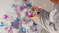 Happy Woman Dressing up the Christmas Tree Arkistovideo