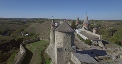 Aerial camera flies around Kamianets-Podilsk castle Stock Footage