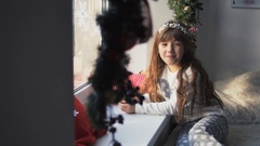 Kid Girl Having Fun near Windowsill Stock Footage