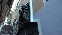 4k Sculpture in small alley building in city Bremen famous streets area Schnoor Stock Footage