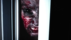 4K Horror Bloody Scary Woman Eye Looking in Door Gap and Screaming Stock Footage