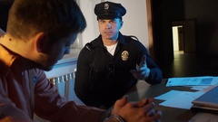 COP USA talking to a criminal defendant Stock Footage