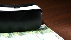 Mobile Virtual Reality Headset and Euro Banknotes. Stock Footage