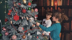 Happy Kids Dressing up the Christmas Tree Stock Footage
