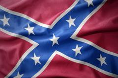 Waving colorful confederate flag Stock Photos