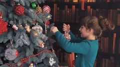Happy Kid Dressing up the Christmas Tree Stock Footage