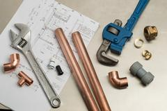 Selection of Plumbers Tools and Plumbing Materials Stock Photos