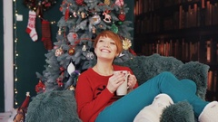 Beautiful Redhead Woman in Armchair Stock Footage