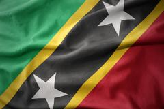 Waving colorful flag of saint kitts and nevis. Stock Photos