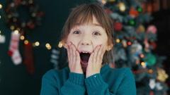Portrait of Wondering Kid Girl Before Christmas Tree Stock Footage