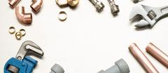 Plumbers Tools and Plumbing Materials Banner with Copy Space Stock Photos
