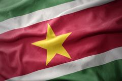 Waving colorful flag of suriname. Stock Photos