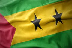Waving colorful flag of sao tome and principe. Stock Photos