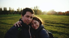 Young man and woman making selfie outdoor strong back light slow motion Stock Footage