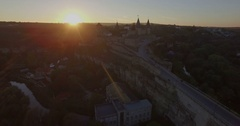 Camera flies towards a sunset Kamianets-Podilsk castle Stock Footage