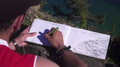 Artist hand drawing a city scenery Stock Footage