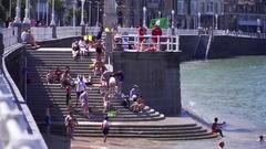 People sunbathing on the seeside in Spain Stock Footage