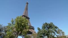 Paris. Champ de Mars. Eiffel tower on sunny summer day. Stock Footage