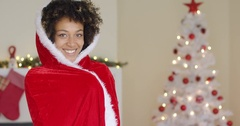 Attractive woman in a red Santa cape with hood Stock Footage