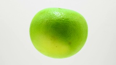 Green grapefruit  suspended in the air rotates in loop    Stock Footage