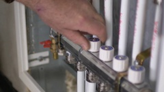 Close up shot of a man increasing the heating in an apartment Stock Footage