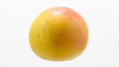 Orange grapefruit  suspended in the air rotates in loop    Stock Footage