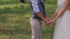 Bride and groom holding hands. at a photo shoot on the wedding day Stock Footage