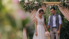 Couple of bride and groom during wedding outdoor registration in forest Stock Footage