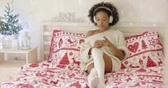Beautiful woman in long sweater on bed Stock Footage