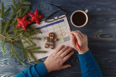 Day 25 of month, calendar on workplace background with morning coffee cup. New y Stock Photos