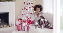 Woman relaxing during the Christmas holiday season Stock Footage