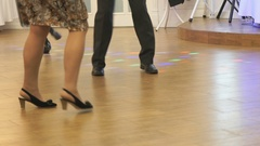 Woman and man dancing at a wedding indoors Stock Footage