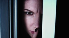 4K Thriller Woman Eye Looking in Door Gap and Showing Shush Stock Footage