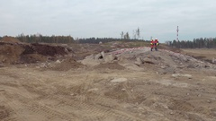 Group of engineers talk on construction site near explosives works area with Stock Footage