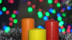 Christmas Candles Light up Magic. Background Bokeh Colored Lights. Stock Footage