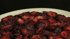Red sliced strawberries in raspberry jam, rotates counterclockwise Stock Footage
