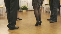 Women's and men feet in moving close up Stock Footage