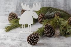 Funny christmas card with reindeer  for a greetings on a wooden background Stock Photos