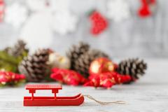 Holiday decoration with Christmas lights and cones over wooden background Stock Photos