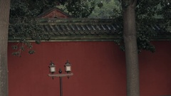 MS Street lamp in front of red wall / Beijing, China Stock Footage