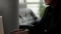 MS TU Side view of businessman typing on laptop Stock Footage