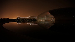 WS Great Hall of the People next to National Grand Theater at night / Beijing, Stock Footage