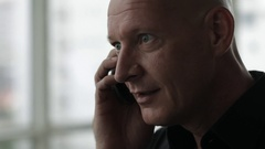 CU Man talking on cellphone Stock Footage