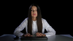 Young girl is terrible to look at the computer display screen Stock Footage